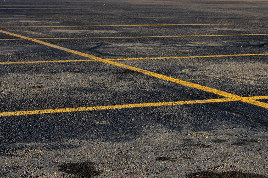 How Repaving Your Parking Lot with Asphalt can Save You Money